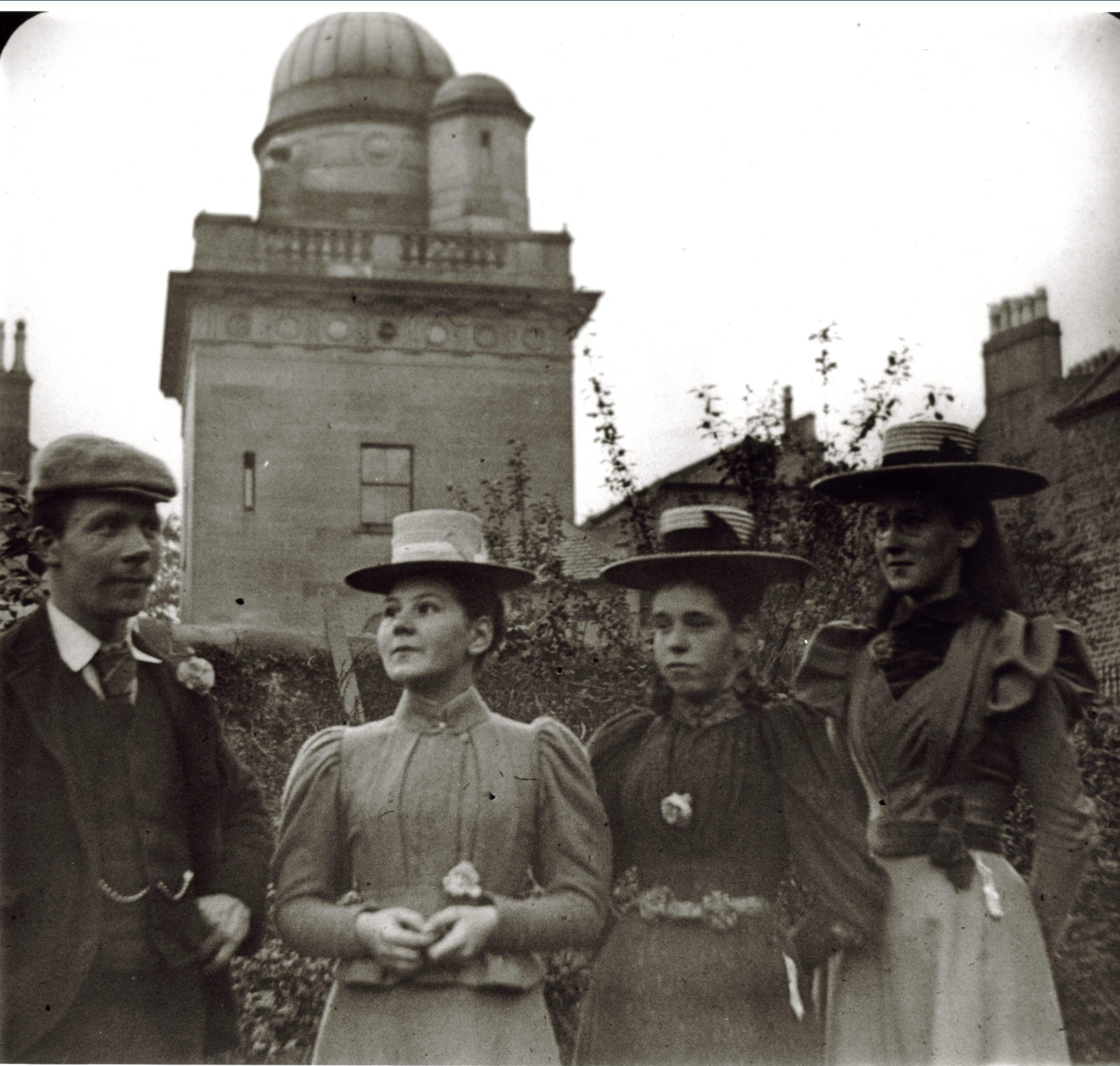Late 19th century photograph of one man and three women outside the Coats Observatory