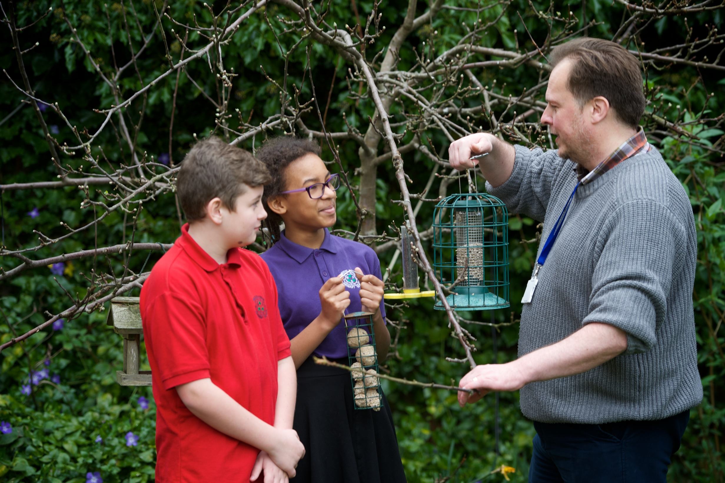 Children learning about birds in the Museum's Garden