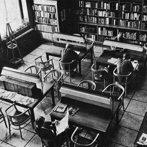 black and white photograph of people using the reading room in the 1970s