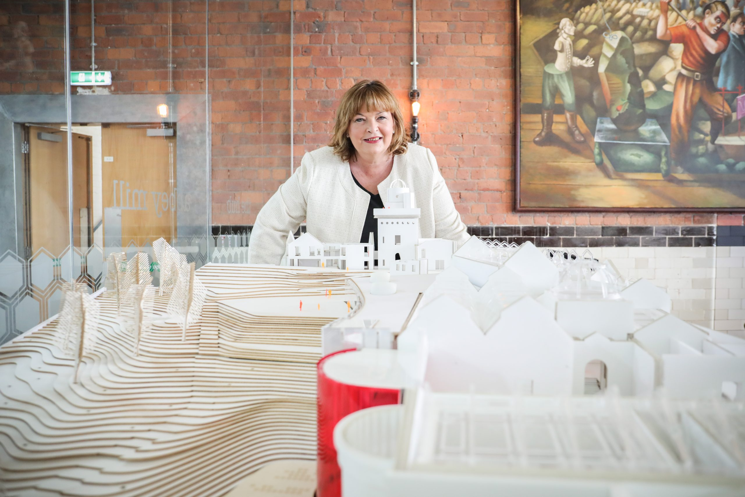 Cabinet Secretary for Economy, Fair Work and Culture, Fiona Hyslop with Paisley Museum model.