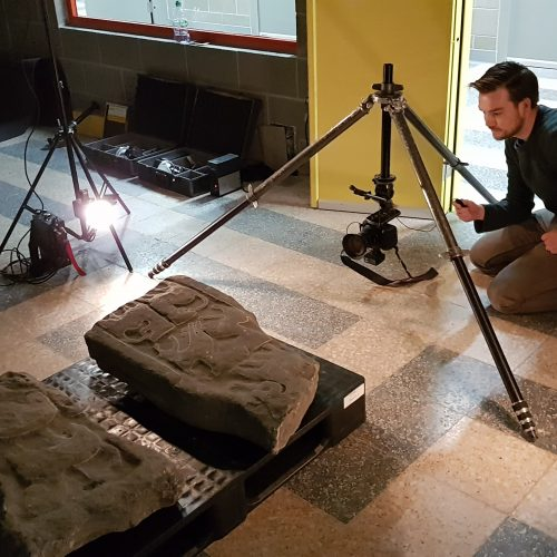 Someone taking high resolution picture of artefact