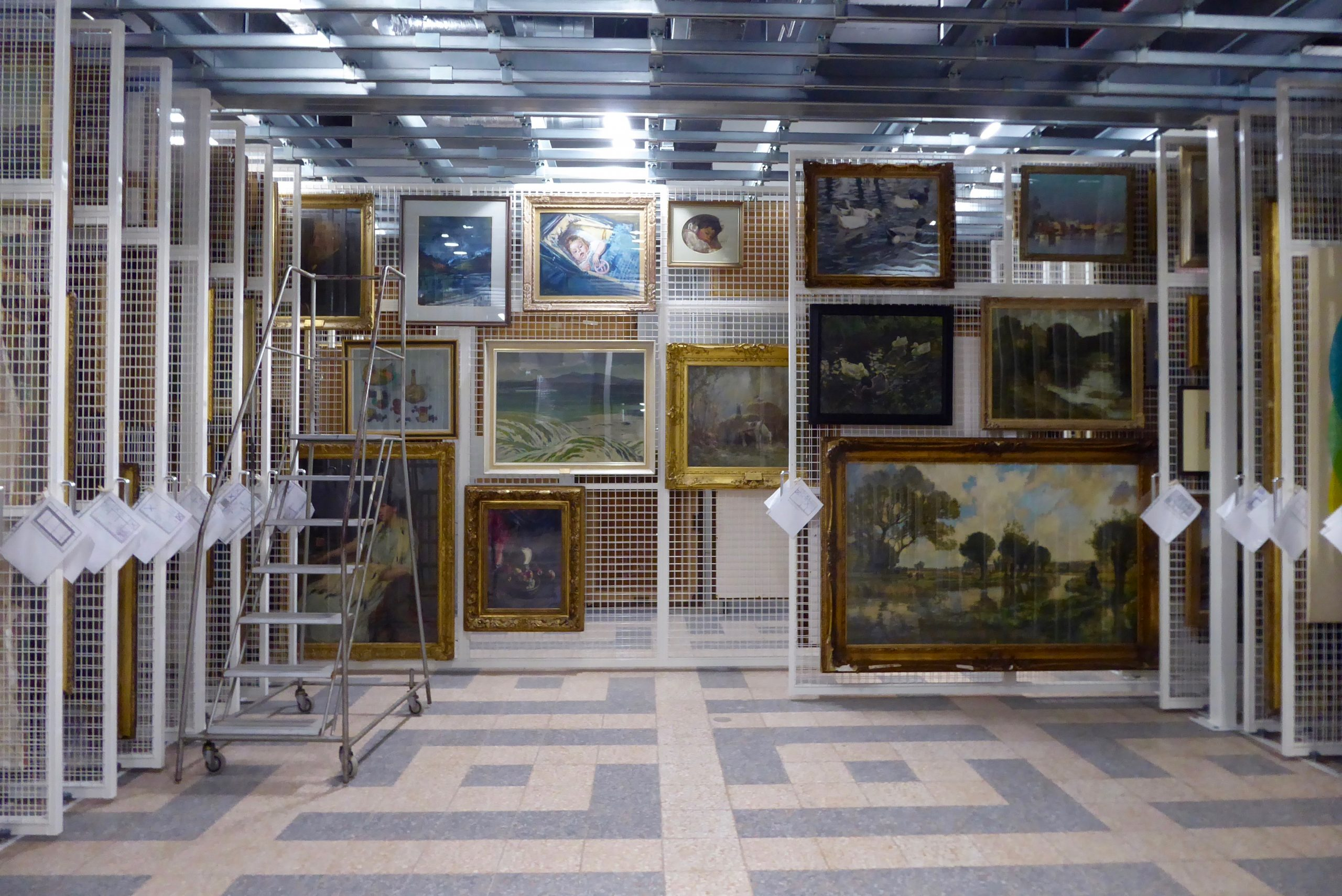 Wall of paintings in Secret Collection