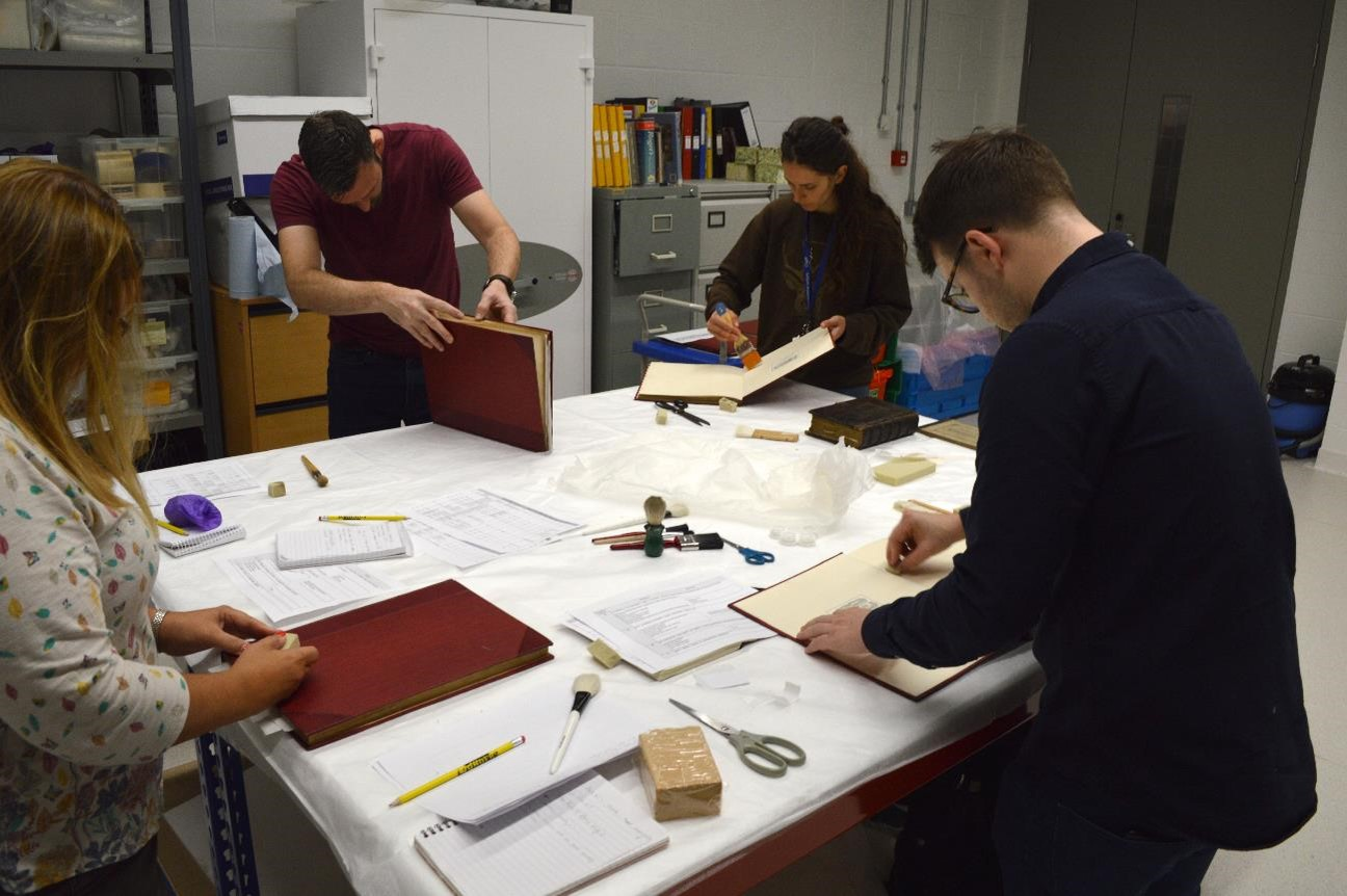 Conserving-Paisleys-Collection-blog-Collections-Management staff carrying out conservation cleaning
