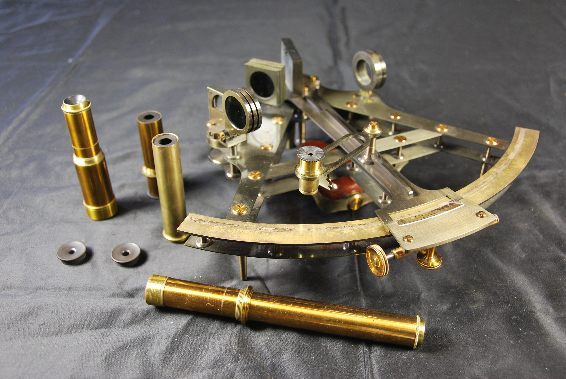 Victorian sextant and lens attachments lying on its side